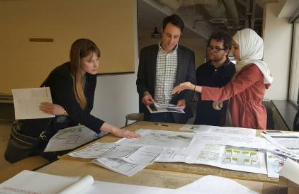 Students benefit from desk crits from visiting architects during career fair.